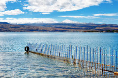 Sevan lake and white clouds blue sky on a sunny day, Armenia Stock Photo