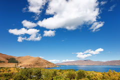 Sevan lake and white clouds blue sky on a sunny day, Armenia Royalty Free Stock Photo