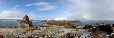 Sevan panorama. Panorama of Sevan Lake, Sevanavank monestary and snowy hills Royalty Free Stock Photo