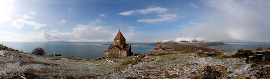 Sevan panorama. Panorama of Sevan Lake, Sevanavank monestary and snowy hills Stock Photos