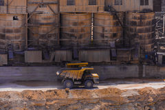 SEVASTOPOL - AUGUST 4, 2015: Old yellow dumper at crushed stone Stock Image