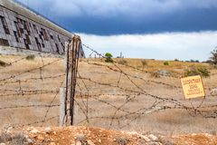 SEVASTOPOL, CRIMEA - SEPTEMBER 2014: Radar station `Dnepr`. SEVASTOPOL, CRIMEA - SEPTEMBER 2014: Old fence military unit with barbed wire. Forbidden zone stock photos