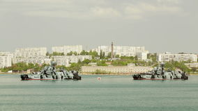 SEVASTOPOL, REPUBLIC OF CRIMEA - MAY 9, 2014: Two. Missile ships of the Russian navy standing on the anchor in chain in the bay ready for the military parade stock video footage