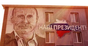 SEVASTOPOL - RUSSIA - AUGUST 2017. Portrait of Russian President Vladimir Putin painted on the wall of the house. Stock Photo