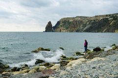 Sevastopol, Russia - September 21, 2014: Rocky cape Fiolent, Jasper beach with  alone figure of woman Stock Photography