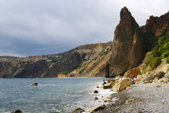 Sevastopol, Russia - September 21, 2014: Rocky cape Fiolent, Jasper beach, view of Krestovaia (Cross) rock Royalty Free Stock Images