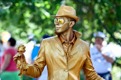 Sevastopol, Russian Federation 26 of July, 2015: Street artist d. Sevastopol, Russian Federation-26 of July, 2015: Street artist dressed as a gold statue takes Royalty Free Stock Image