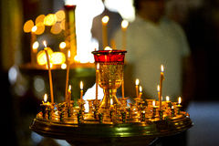 Seveal burning candles in the Orthodox church Stock Photo