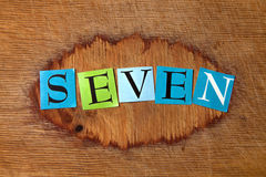Seven. Text on a wooden board Royalty Free Stock Photos