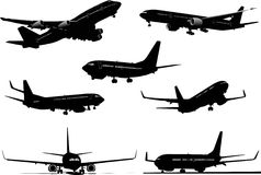 Seven Airplanes silhouettes Stock Images