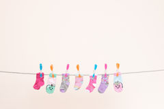 Seven Babies Socks On Washing Line Landscape Royalty Free Stock Photo