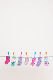 Seven Babies Socks On Washing Line Stock Photos