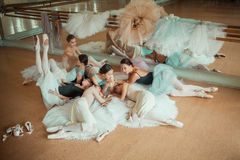 The seven ballerinas against ballet bar Royalty Free Stock Photography