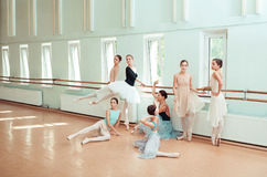 The seven ballerinas at ballet bar stock images