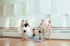 The seven ballerinas at ballet bar stock photo
