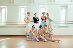 The seven ballerinas at ballet bar Royalty Free Stock Photos