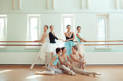 The seven ballerinas at ballet bar Stock Photos