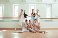 The seven ballerinas at ballet bar Stock Photo