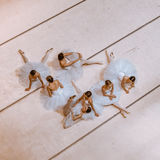 The seven ballerinas on floor Stock Photos