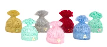 Seven beautiful multi-colored caps - handmade brooches lined up. It`s an invisible athletes - children stand in two rows. And only these warm colorful handmade Stock Images
