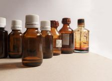 Seven bottles of medical drugs on the gray background stock images