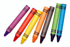 Seven bright colored vax crayons Stock Photo