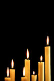 Seven burning candles Stock Images