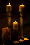 Seven burning candles in the dark. Seven lit candles in the dark stock photo