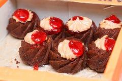 Seven cakes in box closeup Royalty Free Stock Photos