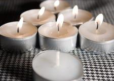 Seven candles Stock Photos