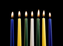 Seven candles isolated Stock Images
