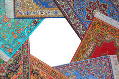Seven carpets lie on circle on white Stock Images