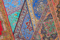 Seven carpets lie in random order on each other Royalty Free Stock Photo