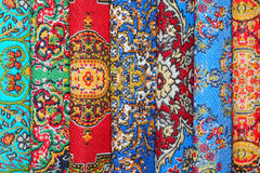 Seven carpets lie in rouleau on each other Royalty Free Stock Photos