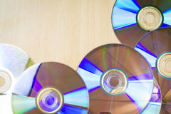 Seven CDs on the wooden table / background texture royalty free stock photography