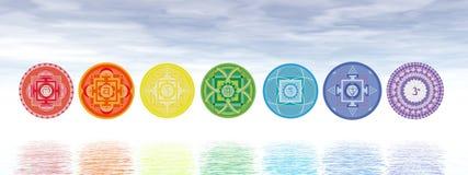 Seven chakra symbols line - 3D render. Seven chakra symbols line upon water in blue background - 3D render Stock Image