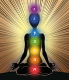 Seven chakras. Man silhouette in yoga position with the symbols of seven chakras Royalty Free Stock Images