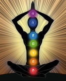 Seven chakras. Man silhouette in yoga position with the symbols of seven chakras Royalty Free Stock Image