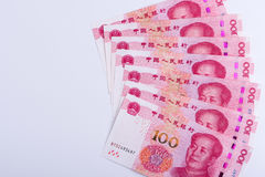 Seven Chinese 100 RMB notes arranged as fan isolated on white ba Royalty Free Stock Photos