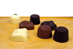 Seven chocolates Royalty Free Stock Images