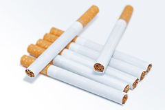 Seven cigarettes. A stack of cigarettes on a white background stock photography
