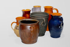 Seven clay pots. In white background Royalty Free Stock Photos