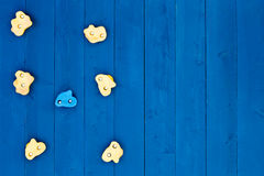 Seven climbing grips on wooden blue wall Stock Image