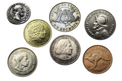Seven coins of different times and countries Royalty Free Stock Image