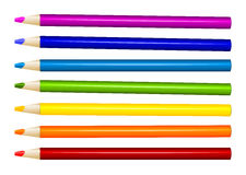 Seven color pencils in arrange in color row on white background Royalty Free Stock Photography