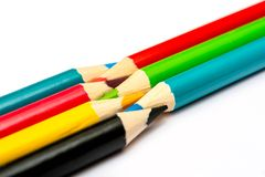 Seven colored pencils. The colors red, green, blue, cyan, magenta, yellow and black. Concept of color profiles converting from RGB. To CMYK stock images