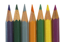Seven colored pencils in a row Stock Photography