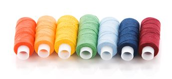 Seven colored spools. With thread look like rainbow Royalty Free Stock Photography