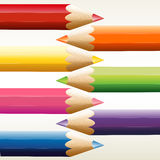 Seven colorful pointed pencils Stock Images