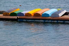 Colorful rowboats. Seven colorful rowboats on the dock Stock Images